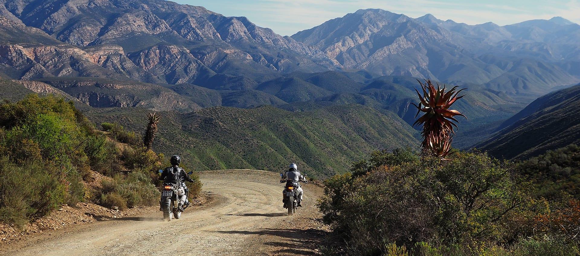 Een avontuurlijke motorreis naar Die Hel, Baviaanskloof, Kaapstad en de Drakensbergen in Zuid-Afrika.